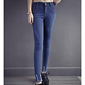 タイトなズボン着用ジーンズ春モデル女性の足のズボンのズボン弾性薄い鉛筆のズボン本物のショット