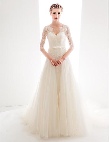 Vestido de novia con encaje transparente